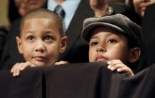Children listen to U.S. President Barack Obama at a DCCC rally in Providence