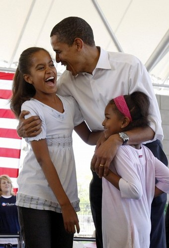 U.S. Presidential candidate Obama shares a moment with his daughters during a picnic in Fort Wayne
