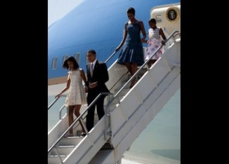 US President Barack Obama (C) walks off