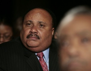 Martin Luther King III listens to Obama at the National Action Network's Keepers of the Dream Awards Gala in New York