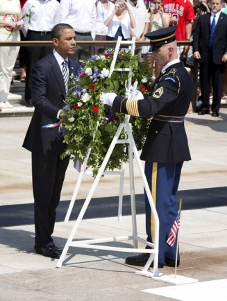 Barack Obama lays a wreath at the Tomb of the Unknown Soldier at the Arlington National Cemetery in Arlington