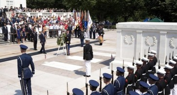 Barack Obama takes part in the wreath laying ceremony at the Tomb of the Unknown Soldier at the Arlington National Cemetery