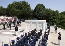 Barack Obama stands at attention during the wreath laying ceremony at the Tomb of the Unknown Soldier in Arlington County
