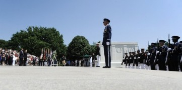Obama and Horst stand at attention after laying a Memorial Day wreath at the Tomb of the Unknowns at Arlington Cemetery in Arlington, Virginia