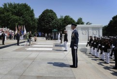 Obama stands for a moment of silence after laying a Memorial Day wreath at the Tomb of the Unknowns at Arlington Cemetery in Arlington, Virginia