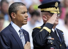 Obama and Commander of the Horst stand together after Obama laid a Memorial Day wreath at the Tomb of the Unknowns at Arlington Cemetery in Arlington, Virginia