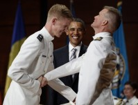 Cadet and father with U.S. President Obama at U.S. Coast Guard Academy commencement exercises in Connecticut