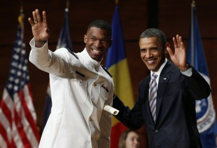 Cadet James waves with U.S. President Obama at U.S. Coast Guard Academy commencement exercises in Connecticut