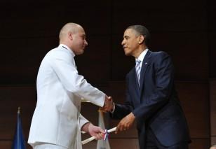US President Barack Obama greets Ionut C