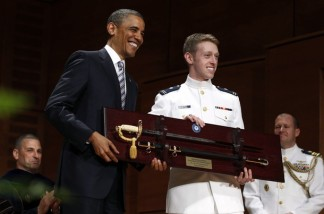 Graduate Nathanael Crum presents gift to U.S. President Obama at U.S. Coast Guard Academy commencement exercises in Connecticut