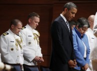 U.S. President Obama and U.S. Secretary of Homeland Security Napolitano pray before the U.S. Coast Guard Academy commencement exercises in New London