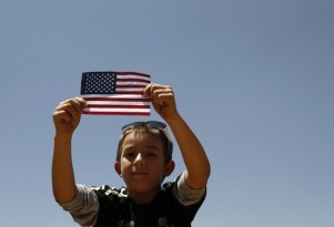A boy listens to U.S. President Barack Obama speak on immigration reform at Chamizal National Memorial Park in El Paso