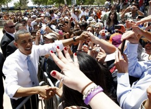 U.S. President Obama greets supporters after delivering remarks on immigration reform at Chamizal National Memorial Park in El Paso