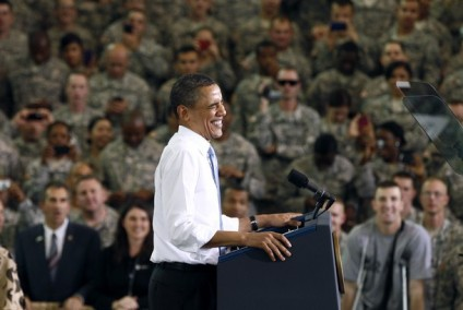 U.S. President Obama smiles as he arrives to speak to troops at Fort Campbell in Kentucky