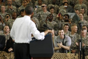 A soldier wounded in Afghanistan applauds as U.S. President Barack Obama speaks to troops at Fort Campbell in Kentucky