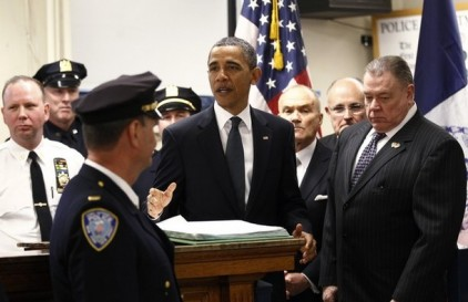 U.S. President Obama speaks with officers of the First Precinct police station in lower Manhattan during a visit to the World Trade Center site in New York