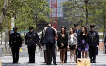 Obama greets a member of the Wall family during a visit to the World Trade Center site in New York