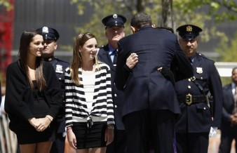 U.S. President Barack Obama greets people during visit to the World Trade Center site in New York