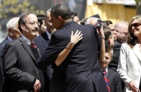 Obama hugs Victoria Giordano during a wreath laying ceremony at the National September 11th Memorial in New York