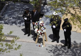 Obama takes a moment of silence during wreath laying ceremony at the National September 11th Memorial in New York