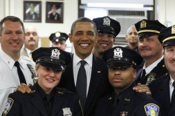 U.S. President Barack Obama poses with officers of the First Precinct police station in lower Manhattan during a visit to the World Trade Center site in New York