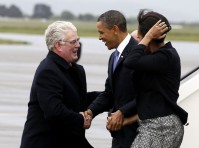 Barack Obama and Michelle Obama is greeted by Chief of Protocol Carol Henney after they arrive in Dublin