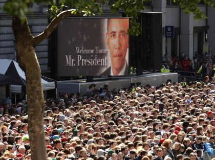 Image of U.S. President Barack Obama is displayed over the crowd awaiting his arrival to address them at College Green in Dublin
