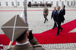 U.S. President Obama walks with Poland's President Komorowski during a welcome ceremony at the Presidential Palace in Warsaw