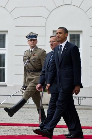 US President Barack Obama (R) walks with