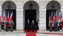 U.S. President Obama and Polish President Komorowski listen to their national anthems during a welcome ceremony at the Presidential Palace in Warsaw