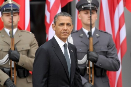 U.S. President Obama inspects the guard of honour during a welcome ceremony at the Presidential Palace in Warsaw