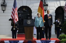U.S. President Obama and German Chancellor Merkel listen to US national anthems during official State Arrival ceremony on South Lawn at White House in Washintgon