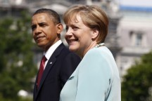 Merkel smiles next to Obama during an official State Arrival ceremony on the South Lawn at the White House