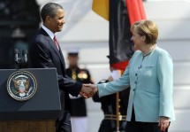 U.S. President Obama shakes hands with German Chancellor Merkel during an official State Arrival ceremony at the White House
