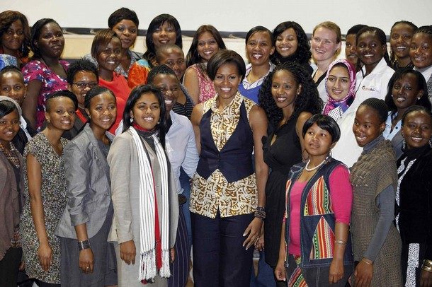 U.S. First Lady Michelle Obama poses for a photo with young women leaders during a visit to the Apartheid Museum in Johannesburg