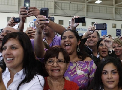 Audience cheers as U.S. President Barack Obama speaks inside hanger at Luis Munoz Marin International Airport in Puerto Rico