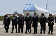 U.S. President Barack Obama walks with officials at Luis Munoz Marin International Airport in Puerto Rico