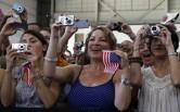 Audience listens as U.S. President Barack Obama speaks inside hanger at Luis Munoz Marin International Airport in Puerto Rico