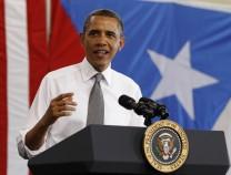 U.S. President Barack Obama speaks inside hanger at Luis Munoz Marin International Airport in Puerto Rico
