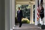 U.S. President Obama walks out to deliver remarks to the press in the Rose Garden of the White House in Washington
