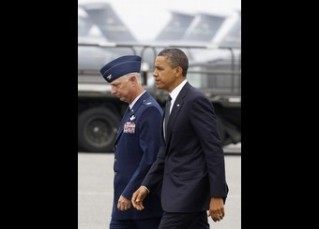 U.S. President Barack Obama walks with USAF Col. Mark Camerer, 436th Airlift Wing Commander, after he arrives at Dover Air Force Base in Delaware