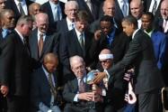 US President Barack Obama hands the trop