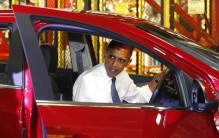 U.S. President Obama sits in a Cheverolet Sonic during his tour with South Korean President Lee of General Motors Orion Assembly in Detroit