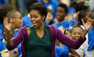 First Lady Michelle Obama (C) launches a