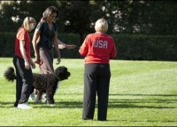 "U.S. First Lady Michelle Obama walks with her dog Bo during a ""Let's Move!"" clinic at the White House"