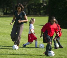 First Lady Michelle Obama plays soccer a
