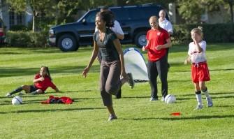 First Lady Michelle Obama runs soccer dr