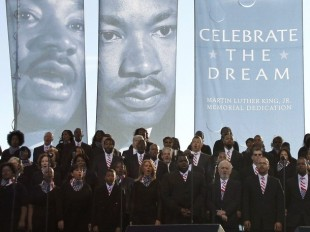 A choir sings on the main stage at the Martin Luther King, Jr. memorial dedication at the National Mall in Washington