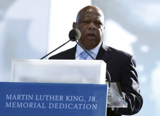 U.S. Representative John Lewis speaks at the Martin Luther King, Jr. memorial dedication on the National Mall in Washington