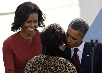 President Barack Obama and first lady Michelle greet Aretha Franklin at the dedication ceremony of the Martin Luther King, Jr. National Memorial in Washington